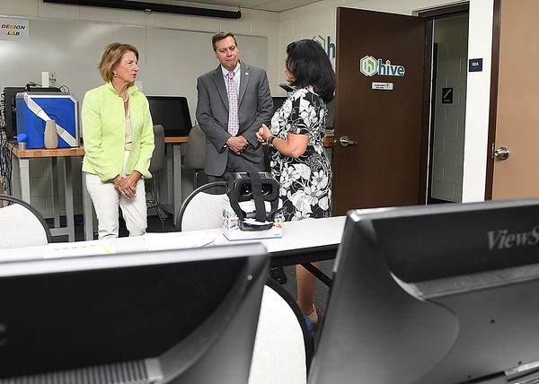 Senator Shelly Moore Capito, left and ARC Co-Chair Tim Thomas, speak with WV HIVE director Judy Moore during a tour  of the HIVE network, an entrepreneurial support network serving locations in Beckley, Summersville, Lewisburg, and Hinton. (Rick Barbero/The Register-Herald)