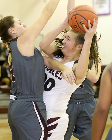 (Brad Davis/The Register-Herald) Woodrow Wilson's Laken Ball battles in the paint before scoring as George Washington's Lauren Harmison, left, defends Thursday night in Beckley.
