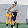 (Brad Davis/For The Register-Herald) WVU Tech's Brittany Dye beats Rio Grande's Trinity Hassey for a header Saturday afternoon at the YMCA Paul Cline Memorial Sports Complex.