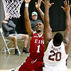 (Brad Davis/The Register-Herald) WVU recruit Derek Culver drives to the basket as Crossroads' (Class AAA) Iran Bennett defends during the Scott Brown memorial game Saturday evening at the Beckley-Raleigh County Convention Center.