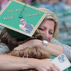 Madeline Beard hugs her mother Kim Beard after receiving her diploma from Greenbrier East High School at the 52nd Annual Commencement ceremony in Fairlea Friday. Jenny Harnish for the Register-Herald
