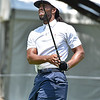 (Brad Davis/The Register-Herald) NFL receiver Larry Fitzgerald watches his fairway shot during Wednesday's Pro-Am in White Sulphur Springs.