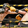 (Brad Davis/The Register-Herald) Austin Cox, left, takes on Hico's Ryan Hurley in a light heavyweight matchup during the Original Toughman Contest Friday night at the Beckley-Raleigh County Convention Center. Cox would win the fight.