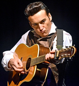 (Brad Davis/The Register-Herald) Country music legend Johnny Cash, a.k.a. British musician Pete Storm, plays some of the greatest hits from the man in black during A Musical Tribute to Johnny Cash Saturday night at the Raleigh Playhouse and Theatre. Storm, a veteran tribute artist who also pays homage to Elvis and Dean Martin, has spent the last 15 years meticulously studying the musicians he portrays and is regarded as one of the best music impersonators in the world. He uses either a full band or backing tracks when he performs and has every detail down to perfection, from the clothing and look down to the moves.