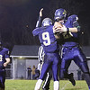 Greenbrier West's Noah Brown celebrates with teammate Kaiden Pack after scoring a touchdown during Friday night's game against Midland Trail at Greenbrier West High School. (Jenny Harnish/The Register-Herald)