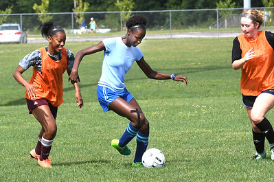 Woodrow Wilson Christyana Jones, left, Mikah Alleyne and Katie Sweeney, practicing at the YMCA Paul Cline Memorial Youth Sports Complex Wednesday morning. (Rick Barbero/The Register-Herald)