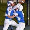 (Brad Davis/The Register-Herald) Midland Trail's Christopher Vines, left, gets a celebratory hug from teammate Colin Dempsey after scoring the go-ahead touchdown during the 3rd quarter against Sherman Friday night in Fairlea.