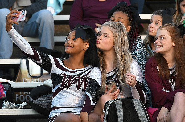 Woodrow Wilson cheerleaders taking a selfie during game againt Morgantown held at Woodrow Wilson High School.<br /> (Rick Barbero/The Register-Herald)