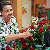 Flowers by Nancy owner Nancy Sturgil puts together a flower arrangement at the store on Tuesday in Beckley. Jenny Harnish/ The Register-Herald