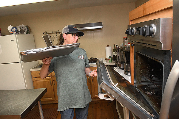 Tabitha Henderson, owner of Tabs Table, operates a catering service out of Athena Farm and Vineyard's kitchen<br /> (Rick Barbero/The Register-Herald)