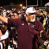 Woodrow Wilson defensive coach Dale Stafford, speaks with his team after the first quarter against Princeton Friday night at VanMeter Stadium in Beckley.<br /> (Rick Barbero/The Register-Herald)