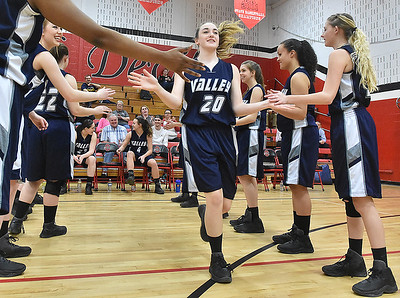 (Brad Davis/The Register-Herald) Valley's (Fayette) Kaylee Nickoson (#20) collects high-fives from all her Greyhound teammates as she's introduced by the public address announcer prior to their opening round game against Midland Trail in the Region 3, Section 1 tournament Saturday evening at Oak Hill High School.