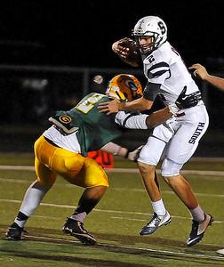 Brad Davis/The Register-Herald Parkersburg South quarterback Garrett Gilkeson tries to slip by Greenbrier East defensive back Ty Walker Friday night in Fairlea.