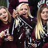 Woodrow Wilson student section reacts as the team enters the field for game against Hurricane Friday night at Van Meter Stadium in Beckley.<br /> (Rick Barbero/The Register-Herald)