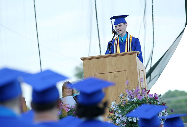 Greenbrier West's Christopher Flanagan, who graduated with highest honors, speaks during their graduation Friday at the State Fairgrounds in Fairlea. (Chris Jackson/The Register-Herald)