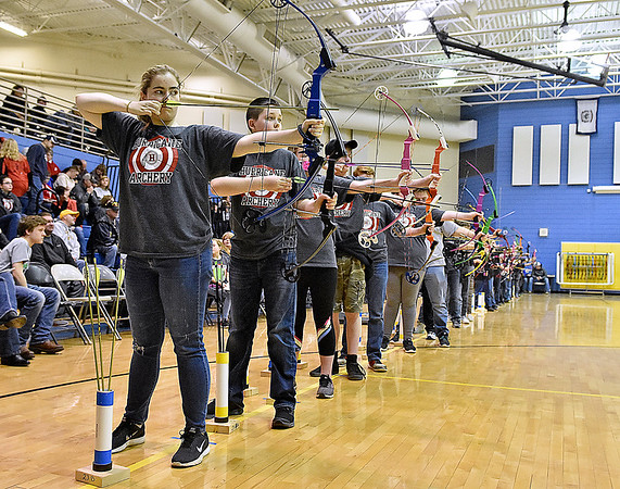 (Brad Davis/The Register-Herald) Young archers from schools across that area take aim during a tournament at Shady Spring Middle School Saturday morning.