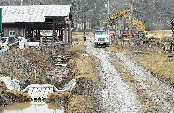 Rick Barbero/The Register-Herald Crew remove dirt because of a diesel spill in Alvin off of Route 92.