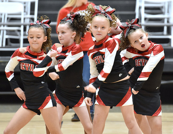 (Brad Davis/The Register-Herald) The Oak Hill Devils B-team takes their turn to perform for the judges during a Youth Cheerleading Competition Sunday afternoon at the Beckley-Raleigh County Convention Center.