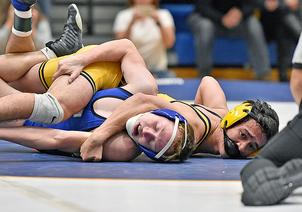 (Brad Davis/The Register-Herald) WVU Tech's Dylan Dennison, right, takes on Ohio Valley University's Tristan Bean in 133-pound weight class match Friday night inside the Van Meter Gym. WVU Tech's Dennison would pin Bean to win the match.