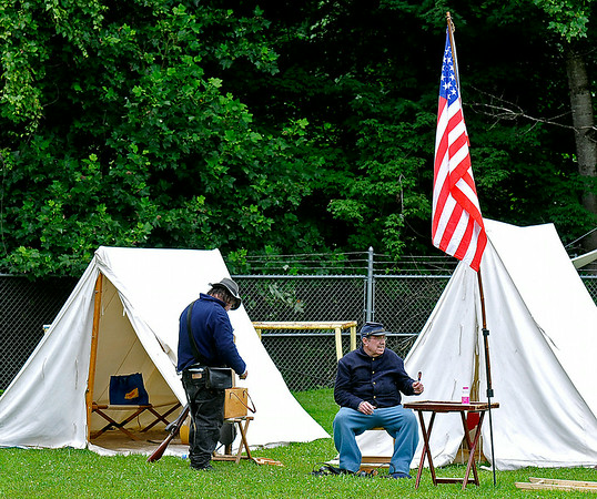 Union infantrymen Dale Lester (left), of Gilbert, and Charlie Stewart, of Lynco, are stationed at their encampment Sunday afternoon at the Oceana Middle School football field. The North and South fought again as re-enactors depicted the skirmish at Methany Chapel, the only Civil War action seen in Wyoming County. Brad Davis/The Register-Herald