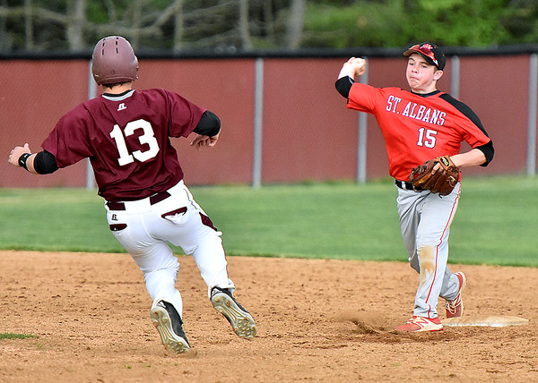 (Brad Davis/The Register-Herald) Woodrow Wilson's Michael Maiolo is forced out at 2nd by St. Albans infielder Casey Kemplin as the Red Dragons turn a double play to end the game Friday evening in Beckley.