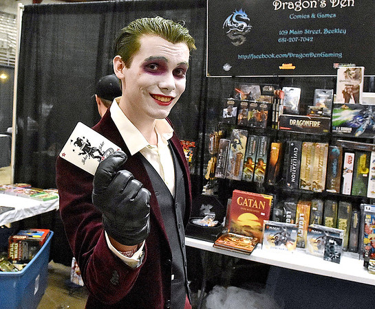 (Brad Davis/The Register-Herald) The Joker, a.k.a. Beckley resident Logan Plumley, poses in character as he shops in the Dragon's Den booth during Causeacon Saturday afternoon at the Beckley-Raleigh County Convention Center.