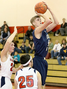 (Brad Davis/The Register-Herald) Greenbrier West's Collin O'Dell pulls up for a short-range jumper as Independence's Jared Cannady, left, and Chance Spencer defend Friday night in Coal City.