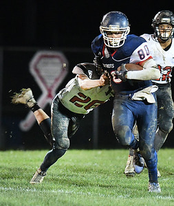 Kaleb Cox, of Independence, right, breaks away from Nathaniel Gordan, of Liberty, during first half action at Independence High School Friday night. (Rick Barbero/The Register-Herald