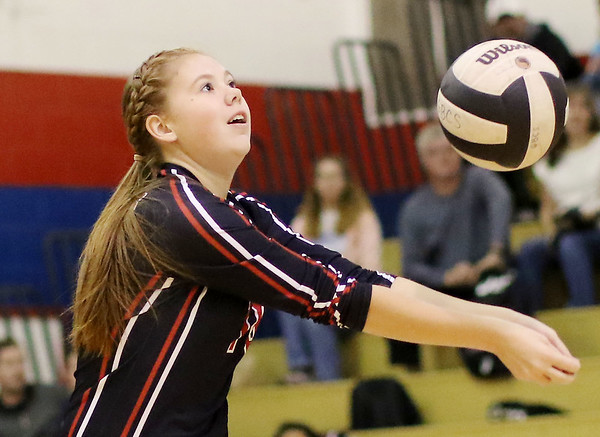 Chris Jackson/The Register-Herald Greater Beckley Christian's Fayth Mitchell (10) vollies during warm-ups at Independence High School.