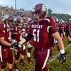 (Brad Davis/The Register-Herald) Woodrow Wilson's Ian Pomeroy goes down the sideline getting teammates up for visiting Parkersburg Friday night in Beckley.