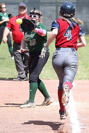 Wyoming East's Andrea Laxton makes a play to get Bluefield's Cara Brown out at first.