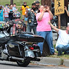 Cecil and Melissa Howard watch a parade of motorcycle veterans as they drive in a Remember the Fallen Ride 2021 in Rainelle Thursday. Jenny Harnish for the Register-Herald