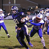 Greenbrier West's Noah Brown is brought down by Midland Trail players during Friday night's game at Greenbrier West High School. (Jenny Harnish/The Register-Herald)