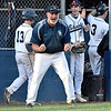 (Brad Davis/The Register-Herald) Shady Spring head coach David Shaw reacts in celebration following Kenneth Sizemore's diving run scored off a squeeze play Wednesday evening in Shady Spring.
