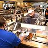 Eddie Torrico, owner of Golden Coral in Beckley, serves some ham to a customer.<br /> Rick BArbero/The Register-Herald)