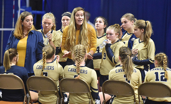 (Brad Davis/The Register-Herald) Greenbrier West assistant Emily Stacy tries to calm her young team during a break in the action against Tyler Consolidated at the State Volleyball Tournament Friday morning at the Charleston Civic Center.