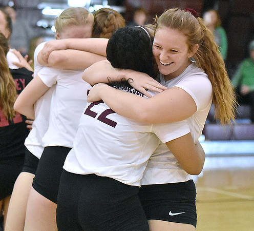 (Brad Davis/The Register-Herald) Woodrow Wilson players Adrian Coalson, right, and Asya Stewart (#22) share a big hug along with the rest of their teammates after defeating George Washington during the Class AAA Regional Volleyball tournament Saturday afternoon, punching their ticket to next week's State Tournament in Charleston.