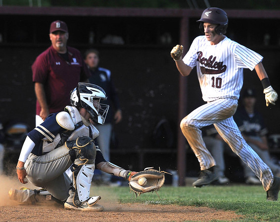 Woodrow's Connor Mollahan sprints toward home plate and scores against Shady catcher Parker Redden providing Woodrow's first lead of the game. 9-8. Jon C. Hancock/for The Register-Herald