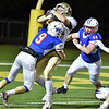 (Brad Davis/The Register-Herald) Williamstown's Eric Brown takes a hit from Midland Trail defender Colin Dempsey (#9) as he rumbles into the endzone Friday night in Fairlea.