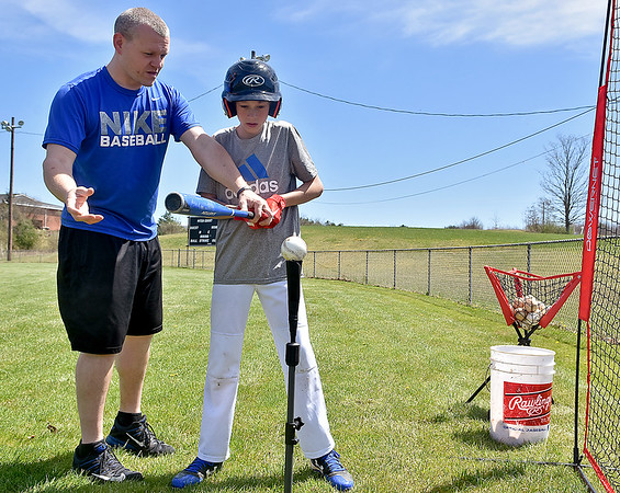 (Brad Davis/The Register-Herald) Young slugger Josh Keiling, 14, gets his turn at one-on-one work on swing mechanics with assistant coach Keith Estep as the Shady Sharks of the Shady Spring Little League's junior division practice at the Beckley Little League fields Sunday afternoon.