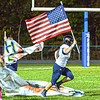 F. Brian Ferguson/Register-Herald Nicholas County thunders onto the field as they visit Midland Trail on Friday.
