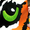Shady Spring High School art student Sydney Harper with one of the murals created by art students for the cafeteria of the school.  Jon C. Hancock/for The Register-Herald