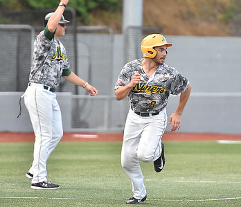 (Brad Davis/The Register-Herald) Miners baserunner Frankie Jezioro (#8) is waved home by third base coach Korey Dunbar as he scores off the bat of teammate Fernando Ortiz during the first game of a double header against Champion City Wednesday at Linda K. Epling Stadium.