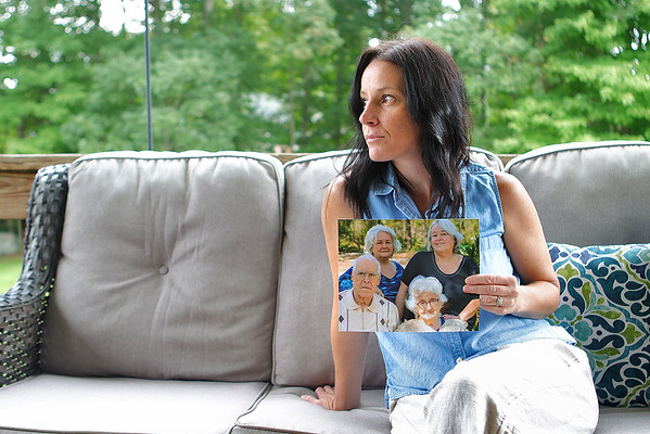 Danielle Lilly holds a photo of her grandparents, her mom and her aunt at her home in Shady Spring. All four of them died of COVID-19, three of them in August. None of them had gotten the vaccine. Jenny Harnish/The Register-Herald