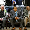 (Brad Davis/The Register-Herald) Longtime area basketball fixture Lewis D'Antoni, left, mans the Jan-Care (Class AA) bench as an assistant with Derek and Herbie Brooks during the Scott Brown memorial game Saturday evening at the Beckley-Raleigh County Convention Center.