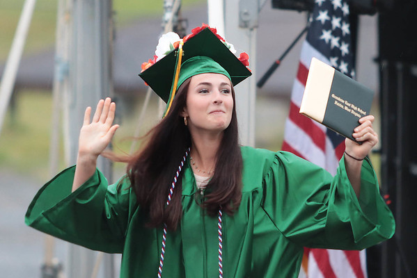 Annabelle Honaker celebrates after receiving her diploma from Greenbrier East High School at the 52nd Annual Commencement ceremony in Fairlea Friday. Jenny Harnish for the Register-Herald