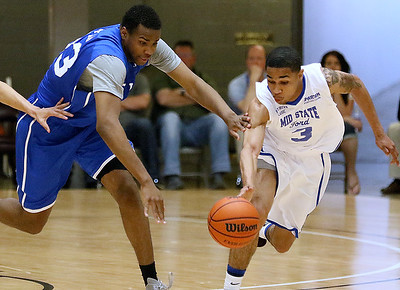 (Brad Davis/The Register-Herald) Mid-State Ford's (Class AAA) Justin Phillips, right, races for a loose ball with EIN's (National) L.J. Bryan during the Scott Brown Classic Saturday night at the Beckley-Raleigh County Convention Center.