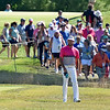 (Brad Davis/The Register-Herald) A hoard of fans follows local favorite Bubba Watson as he makes his way to the 15 green during the Military Tribute at The Greenbrier Sunday afternoon in White Sulphur Springs.