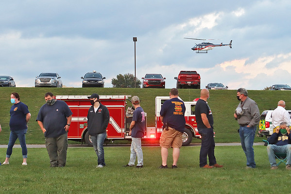 A hospital helicopter takes off during a prayer vigil at Greenbrier Valley Medical Center in Fairlea Tuesday. The vigil was organized by Senator Stephen Baldwin, President of the Greenbrier County COVID Task Force, to pray for patients and medical professionals battling the delta variant and honoring those who have lost their lives to the virus. Jenny Harnish/The Register-Herald
