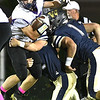 Grant Lively, of James Monroe, left, fights for a few yards against Greenbrier West during the first half Friday evening at Greenbrier West High School.<br /> (Rick Barbero/The Register-Herald)